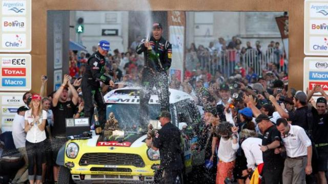 Nani Roma of Spain and co-pilot celebrate winning the car title of the South American edition of the Dakar Rally 2014 in Valparaiso
